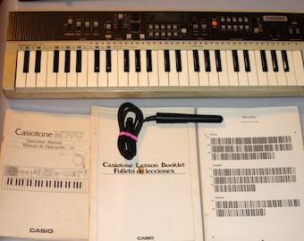 Casio MT-70 Analog Keyboard with Manuals, Songs and Barcode Scanner Synthesizer Vintage 1980s