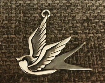 Swallow tattoo sterling silver pendant