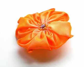 pretty ribbon flower brooch in orange and pink