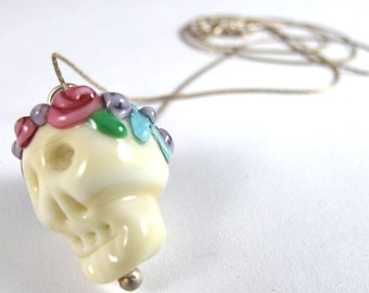 Free Shipping for this Flower Covered Handmade Glass Skull Bead that Dangles from a Simple Sterling Silver Chain