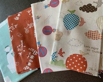 Japanese linen & designer fabric with cute kawaii hot air balloons, bicycles, trains