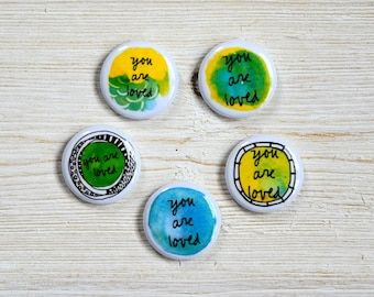 you are loved - 1 inch button, keychain, zipper pull, charm, wearable magnet - blue + green - single blessing button