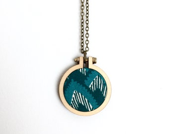Recycled Fabric Necklace or Brooch. Green. Mountains. Leaves. Lines. Bold. Pretty. Unique. Handmade pendant. Mini hoop frame. Recycled.