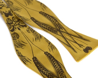 """Beer bow tie. Golden yellow """"lager"""" print. Screenprinted hops barley and wheat freestyle self-tie style."""