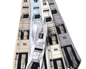Saturn V rocket men's necktie. Silkscreened microfiber tie. Black or white printing ink. Choose standard, narrow, skinny or XL.