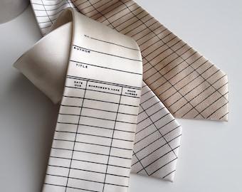 Library date due necktie. Due date card tie. Silkscreen printed men's tie. Literary, teacher, librarian, writer, bookworm, reading gift.