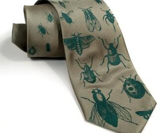 "Bug tie. Silkscreened insect pattern men's necktie, dark emerald print on sage green. ""Bugger Off."" Choose standard, narrow or skinny"