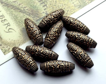 10 bohemian Black & Gold Moroccan oval beads 23x9mm