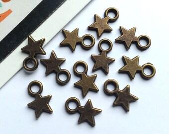 Bulk Lot 100 mini bronze star charms 10x7mm dark brass tiny trinkets