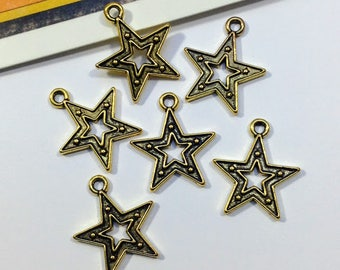 10 gold tone Star Charms 18x16mm