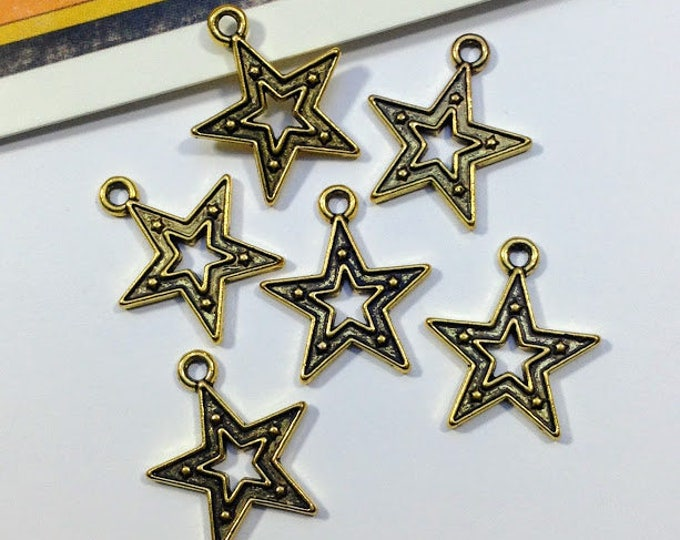 10 gold tone Star Charms 18x16mm antiqued gold metal celestial trinkets, 70s style disco stars