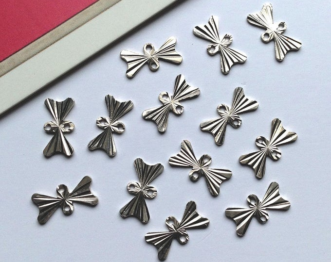 Bulk Lot 50 mini 10x5mm silvertone metal BOW connector charms, tiny flat bows #139