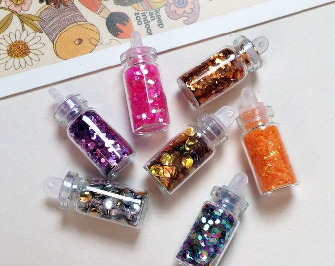 Mini Glass Bottle Charm 28x11mm bead filled tiny trinkets for fairy themes #138a