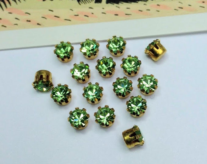 12 vintage Swarovski 17ss stones, light green 4mm sparkling rhinestones set into brass, 1960s