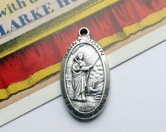 Vintage St John medal 29x16mm silvertone religious charm