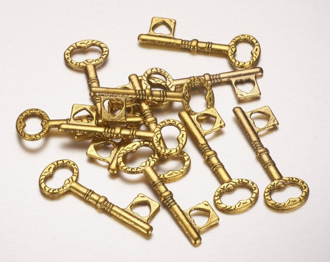10 small gold skeleton key charms 34x12mm