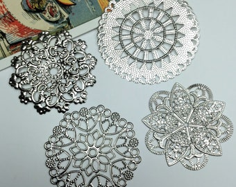 4 silver tone filigree stampings 45mm to 55mm
