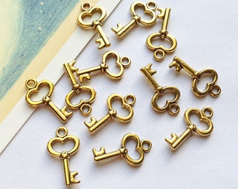 10 mini gold key charms 15x9mm small wedding favours trinkets / tiny keys