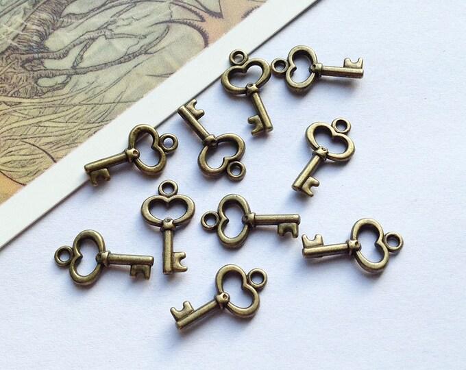 Bulk Lot 50 mini bronze KEY charms 15x9mm