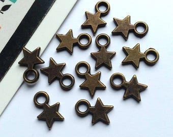 10 mini bronze star charms 10x7mm dark brass tiny trinkets