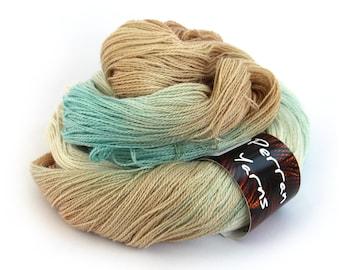 Sparkly laceweight merino silk yarn handdyed in shade Sandy Toes