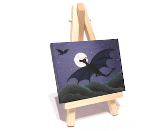 Original Dragon Miniature Art - small acrylic painting with a dragon silhouette flying in a night sky with full moon. Mini canvas on easel