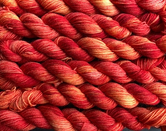 006 - 20g mini skein - 4ply platinum sock yarn - 75/25 BFL (Blue-faced Leicester) superwash wool and nylon - fiery orange and red variegated
