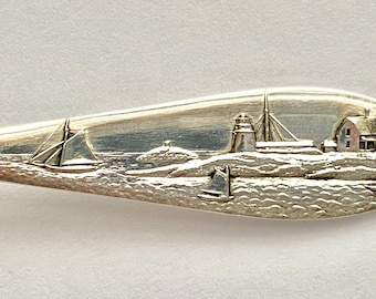 Extremely Rare Marblehead,MA, Daniel Low Spoon. Old Lighthouse, boats, harbor. Sterling silver.