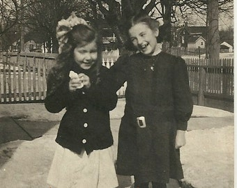 Laughing girls friendship snow childhood friends vintage photo dresses smiling happy