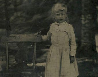 Outdoor tintype blonde hair girl with empty chair vintage photo Victorian childhood