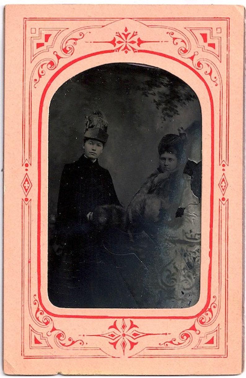 1887 tintype winter girls muff Reed City photo Id'd hats image 0