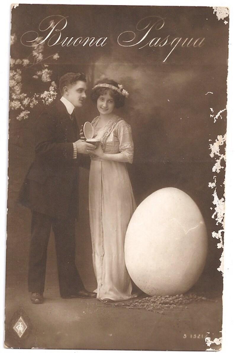 Surreal vintage Easter couple postcard Italian Buona Pasqua image 0