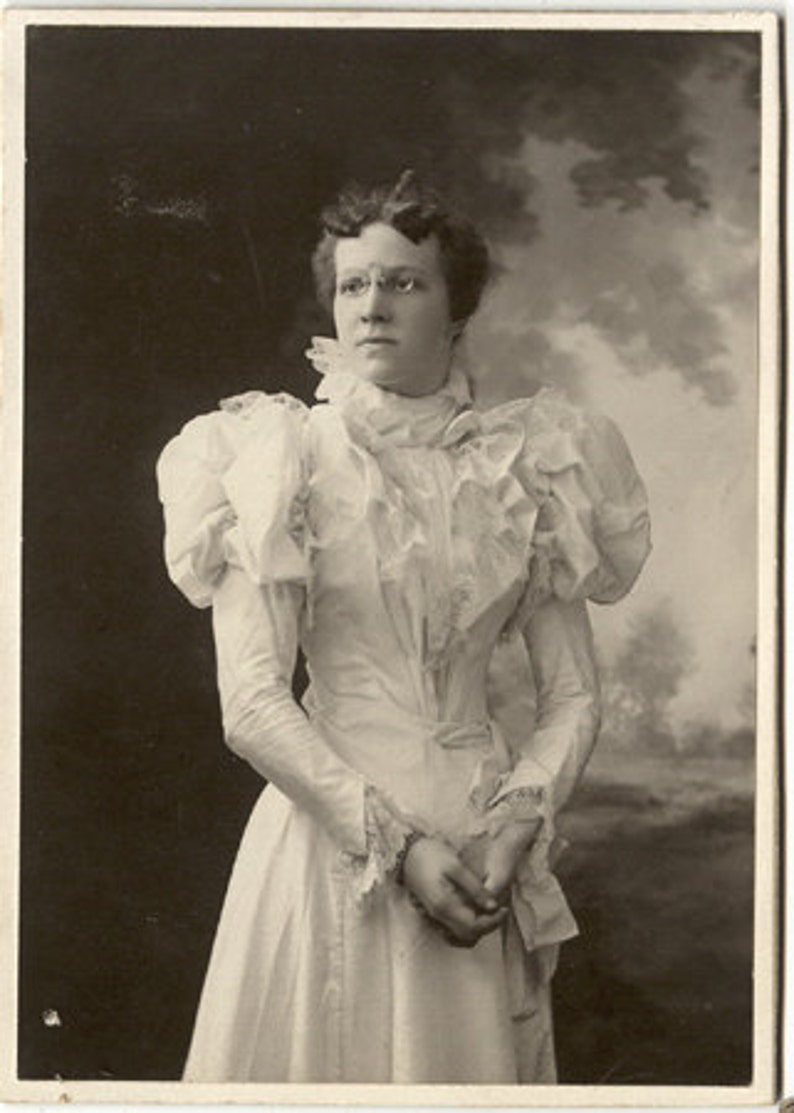 1890s white gown glasses young lady image 0