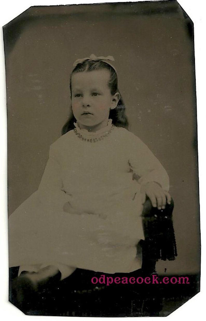 Beautiful little girl tinted tintype photo vintage jewelry bow image 0