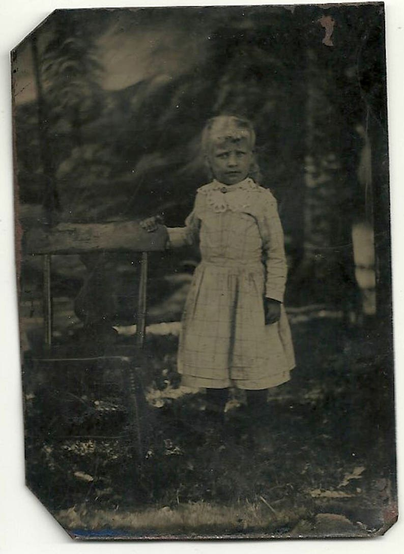 Outdoor tintype blonde hair girl with empty chair vintage image 0