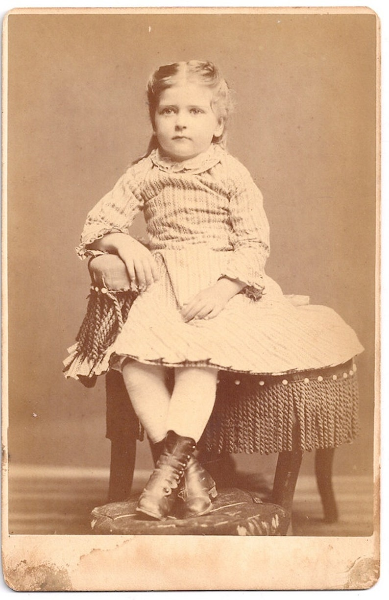 Beautiful little girl in photographer' s chair Lancaster image 0