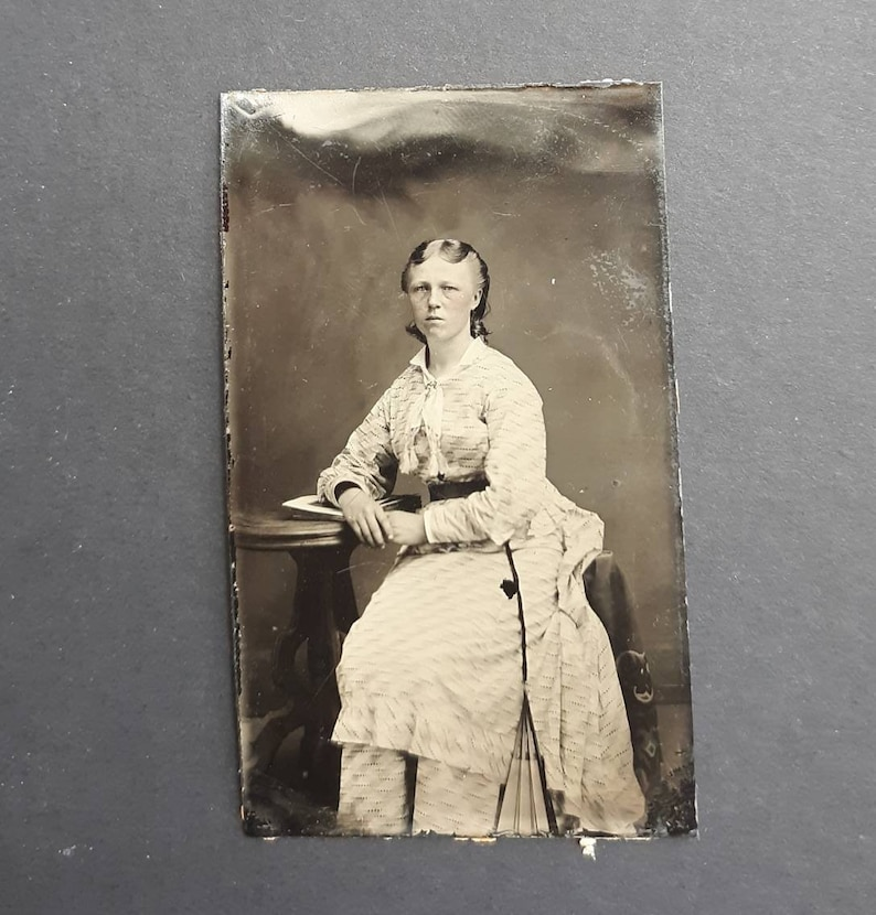 Afternoon with a fan serious woman book table vintage photo image 0