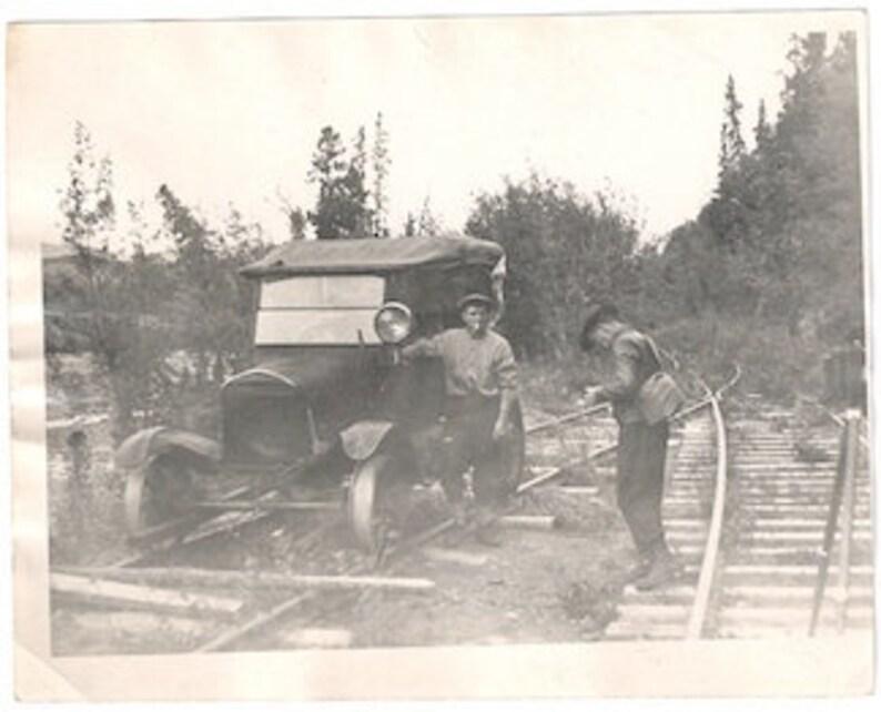 Photographer model-t train  world war snapshot black and white image 0