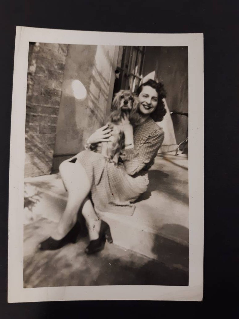 Vintage dog photo 1940s pin up clothing heels smiling lady image 0