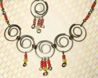 Boho bib necklace,  statement necklace with gunmetal spirals, dangle earrings included