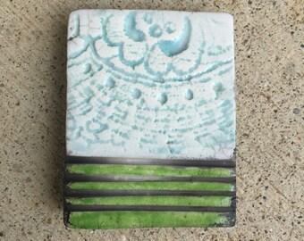 farm field with lacy clouds, raku, clay pendant, tile