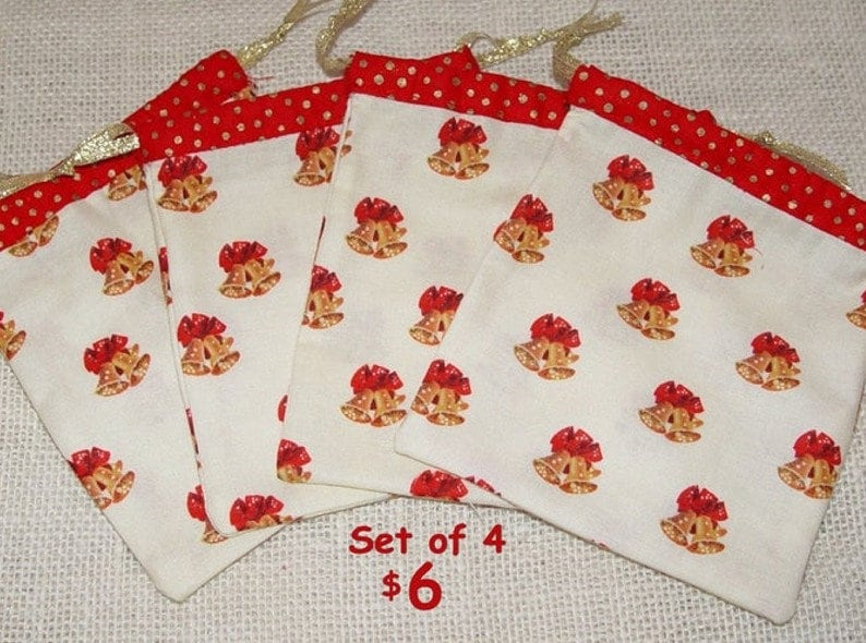 drawstring pouch w small gift bags red and gold bells and bows Christmas party favor bags