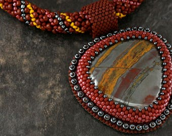 Bead embroidery necklace. Tiger Iron. Cabochon. Glass.