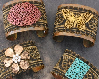 Antique French ribbon adjustable cuff with filigree embellishment. Brass blank patinaed and ribbon embellishment.