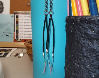 Long seed bead beaded earrings. Trendy fringe tassel earrings in turquoise, black, white, and copper with chain.