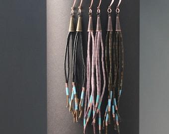 Long beaded fringe tassel earrings. Vintage, antique, and new seed bead dangle shoulder duster earrings. Metal cones.