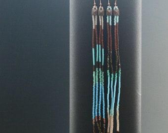 Long beaded fringe tassel earrings. Vintage, antique, and new seed bead dangle shoulder duster earrings.