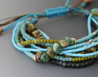 Multi-strand bracelet with macrame sliding knot. One size fits most. Turquoise, copper, sterling jewelry.