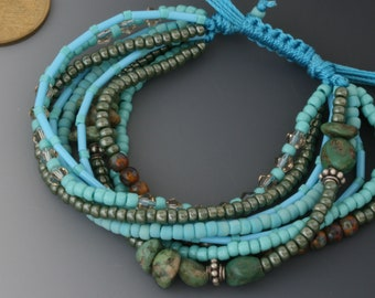 Multi-strand bracelet with macrame sliding knot. One size fits most. Turquoise and copper jewelry.