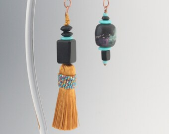 Fan or light pulls with hand beaded tassel.